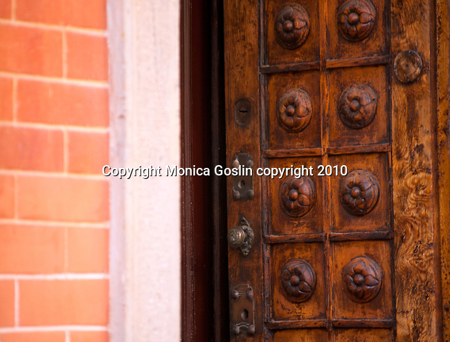 Open antique door in Como, Italy on Lake Como