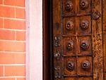 Open antique door in Como, Italy on Lake Como