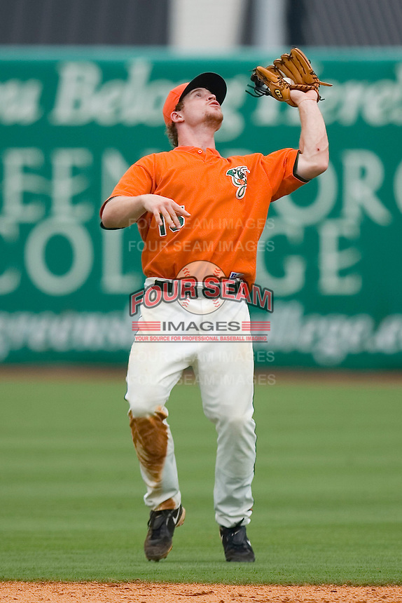 Shortstop Paul Gran #15 of the Greensboro Grasshoppers catches a pop fly at NewBridge Bank Park June 20, 2009 in Greensboro, North Carolina. (Photo by Brian Westerholt / Four Seam Images)
