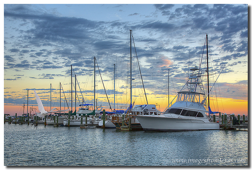 Colors begin to paint the Texas Gulf Coast skies on this autumn morning. This Rockport image shows the boats in the harbor in the early morning hours. The air was cool and the shrimp boats were beginning to return from their nightly journeys.
