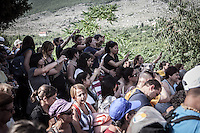 Pilgrims filming the visionary  Mirjana Dragicevic after the apparition  of July 2 at the Blue Cross, Podbro hill.  <br />