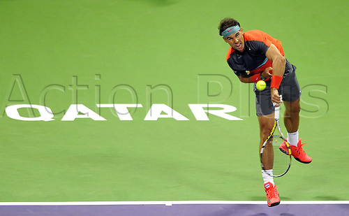 03.01.2014. Doha, Qatar.  Rafael Nadal of Spain serves the ball during the men s singles semifinal match against Peter Gojowczyk of Germany in Qatar Open tennis tournament, Jan. 3, 2014. Nadal won 2-1.