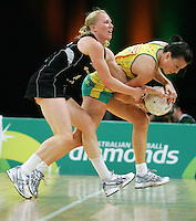 02.11.2008 Silver Ferns Laura Langman and Australia's Natalie von Bertouch in action during the Holden International Netball test match between the Silver Ferns and Australia played at Brisbane Entertainment Centre in Brisbane Australia. Mandatory Photo Credit ©Michael Bradley.