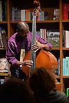 CORAL GABLES, FL - FEBRUARY 06: Avery Sharpe of The Avery Sharpe Trio band perform during a discussion and book signing of Jasmine Guy book 'Afeni Shakur: Evolution of a revolutionary' at Books and Books on Friday February 6, 2015 in Coral Gables, Florida. (Photo by Johnny Louis/jlnphotography.com)