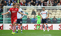 Preston North End's Ben Davies looks dejected after Barnsley's Cameron McGeehan (left) scores his side's first goal  <br /> <br /> Photographer Kevin Barnes/CameraSport<br /> <br /> The EFL Sky Bet Championship - Preston North End v Barnsley - Saturday 5th October 2019 - Deepdale Stadium - Preston<br /> <br /> World Copyright © 2019 CameraSport. All rights reserved. 43 Linden Ave. Countesthorpe. Leicester. England. LE8 5PG - Tel: +44 (0) 116 277 4147 - admin@camerasport.com - www.camerasport.com