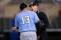 Home plate umpire Ryan Powers listens as Hickory Crawdads manager Steve Mintz (13) argues a call during the game against the Kannapolis Intimidators at Kannapolis Intimidators Stadium on April 9, 2016 in Kannapolis, North Carolina.  The Crawdads defeated the Intimidators 6-1 in 10 innings.  (Brian Westerholt/Four Seam Images)