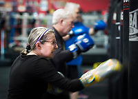 NWA Democrat-Gazette/CHARLIE KAIJO Jonelle Lipscomb practices boxing swings during a boxing class geared towards people with Parkinson's disease, Monday, December 10, 2018 at Straightright Boxing and Fitness Springdale.