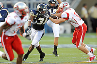 9 October 2010:  FIU linebacker Jarvis Wilson (31) attempts to break away from Western Kentucky wide receiver Dustin Boyer (16) as the FIU Golden Panthers defeated the Western Kentucky Hilltoppers, 28-21, at FIU Stadium in Miami, Florida.