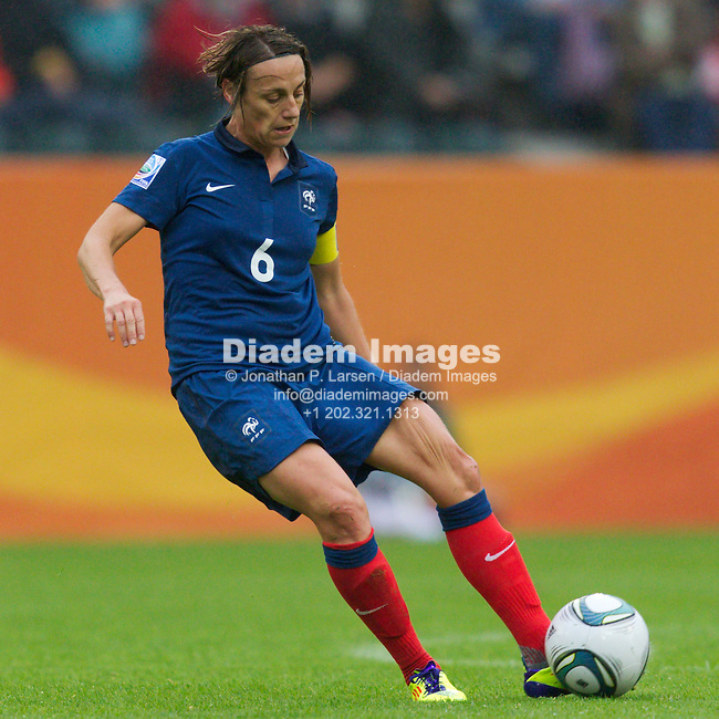 MOENCHENGLADBACH, GERMANY - JULY 13:  France team captain Sandrine Soubeyrand kicks the ball during a FIFA Women's World Cup semifinal soccer match against the United States at Stadion im Borussia Park on July 13, 2011  in Moenchengladbach, Germany.  Editorial use only.  Commercial use prohibited.  No push to mobile device usage.  (Photograph by Jonathan P. Larsen)