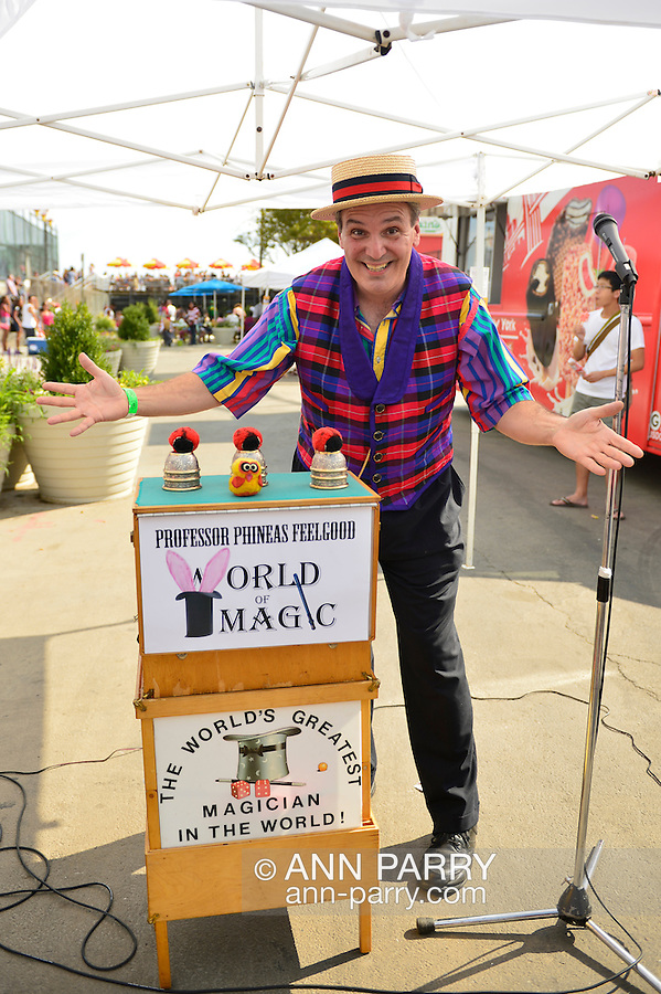 Brooklyn; New York; U.S. - August 9; 2014 - Professor Phineas Feelgood, AKA Bob Yorburg of Yorktown Heights, performs magic at the Fourth Annual History Day at Deno's Wonder Wheel Amusement Park and The Coney Island History Project, has family fun music, history, and entertainment at historic Coney Island.
