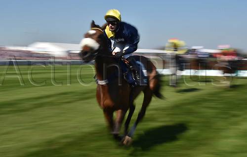 April 8th 2017, Aintree Racecourse, Liverpool, England; Randox Health Grand National Festival Horse racing, Grand National Day; Charbel ridden by David Bass leads at the start of the Doom Bar Maghull Novices Chase