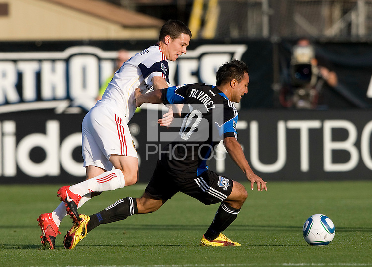 Arturo Alvarez of Earthquakes controls the ball away from Will Johnson of Real Salt Lake during the game at Buck Shaw Stadium in Santa Clara, California on March 27th, 2010.   Real Salt Lake defeated San Jose Earthquakes, 3-0.