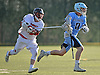 Jack Egan #3 of Oceanside, right, gets pressured by Greg O'Brien #30 of Syosset during a Nassau County varsity boys lacrosse game at Syosset-Woodbury Community Park on Tuesday, Apr. 12, 2016. Syosset won by a score of 18-4.
