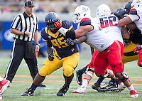 Saturday, November 2nd, 2013: California's Jacobi Hunter tries to beat Arizona's lineman during a game at Memorial Stadium, Berkeley, Final Score: Arizona defeated California 33-28