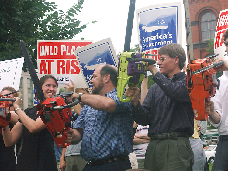 7/2/03.21 CHAINSAW SALUTE--Tiernan Sittenfeld, of the U.S PIRG Conservation Program, Marty Hayden, Earthjustice legislative director, beard, and Sean Cosgrove, Sierra Club national forest policy specialist, and other activists from several environmental groups rev up 21 chainsaws in a protest against the Bush administration's national forest policies. Groups represented included: Alaska Coalition, Alaska Rainforest Campaign, Alaska Wilderness League, Defenders of Wildlife, Earthjustice, Heritage Forests Campaign, National Environmental Trust, Sierra Club and U.S. PIRG..CONGRESSIONAL QUARTERLY PHOTO BY SCOTT J. FERRELL