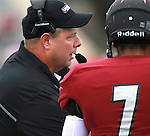 Lindenwood University - Belleville head coach Jeff Fisher talks to QB Anthony Dorsey (7) late in the first half of their Homecoming Game against the Menlo College Oaks.