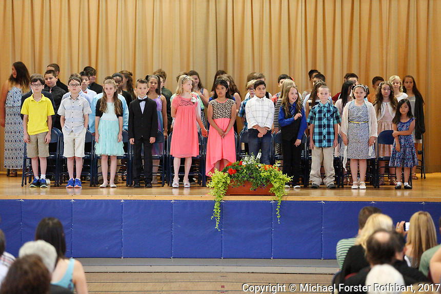 The Oneonta Greater Plains elementary school fifth grade awards ceremony, on June 21, 2017.<br /> &copy; Michael Forster Rothbart Photography<br /> www.mfrphoto.org &bull; 607-267-4893<br /> 34 Spruce St, Oneonta, NY 13820<br /> 86 Three Mile Pond Rd, Vassalboro, ME 04989<br /> info@mfrphoto.org<br /> Photo by: Michael Forster Rothbart<br /> Date:  6/21/2017<br /> File#:  Canon &mdash; Canon EOS 5D Mark III digital camera frame C19075
