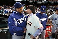 SAN FRANCISCO - SEPTEMBER 14:  Los Angeles Dodgers manager Joe Torre #6 talks with filmmaker Ken Burns, co-director of 'The Tenth Inning', PBS's newest production, before the game between the Los Angeles Dodgers and San Francisco Giants at AT&T Park on September 14, 2010 in San Francisco, California. Photo by Brad Mangin