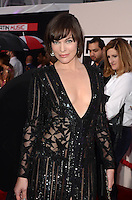 LOS ANGELES, CA - NOVEMBER 20: Milla Jovovich at Westwood One on the carpet at the 2016 American Music Awards at the Microsoft Theater in Los Angeles, California on November 20, 2016. Credit: David Edwards/MediaPunch