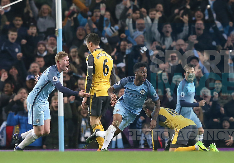 Raheem Sterling of Manchester City (r) celebrates scoring their second goal during the English Premier League match at the Etihad Stadium, Manchester. Picture date: December 18th, 2016. Picture credit should read: Simon Bellis/Sportimage