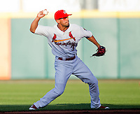 Jose Garcia (3) of the Springfield Cardinals throws to first base during a game against the St. Louis Cardinals at Hammons Field on April 2, 2012 in Springfield, Missouri. (David Welker/Four Seam Images)