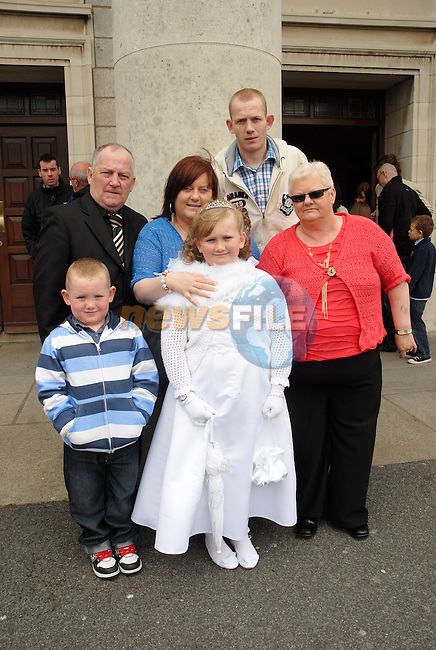 Katelyn Rose Brady who made her Fist Holy Communion in The Lourdes Church on Saturday wi th her parents Lynn and Martin, grandparents Peter and Joe Brady and brother Conor (5).