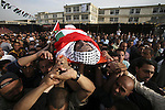Palestinians mourners carry the body of Palestinian prisoner Raed Abu Hamad, who died in an Israeli jail, during his funeral in Al-Azariya on the outskirts of Jerusalem on April 18, 2010. Palestinians held rallies and vigils in an annual day of support for the thousands of Palestinians held in Israeli prisons, two days after Abu Hamad died in custody. Prisons service officials, quoted in the Israeli media, said Abu Hamad, 31, had a history of medical problems and that his death was being investigated. Photo by Mohamar Awad