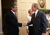 United States President George W. Bush welcomes Secretary of Commerce Carlos Gutierrez and his wife Edilia Gutierrez to the Oval Office Monday, Feb.ruary7, 2005.  Mr. Gutierrez, a native of Cuba and former chairman of the board and chief executive officer of the Kellogg Company, was sworn in by White House Chief of Staff Andrew Card earlier in the day. <br /> Mandatory Credit: Eric A. Draper / White House via CNP