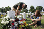 Adam Cockerham, 19, of Greensboro, grieves for his brother, Marine CPL Benny Gray Cockerham, III, next to their mother Jill Cockerham, of Winston-Salem, at Arlington National Cemetery.  Gray Cockerham was killed in action in Iraq in October, 2005.