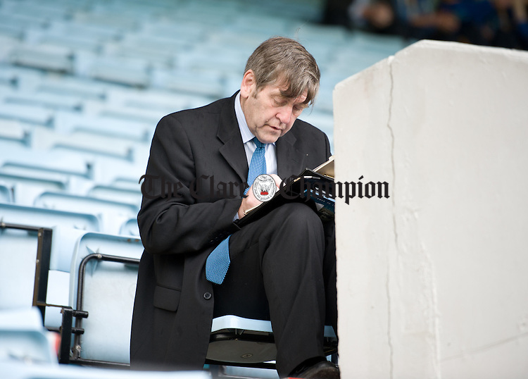 Clare GAA secretary Pat Fitzgerald gets his paperwork in order during a quiet moment before the Munster minor hurling final against Tipperary at Pairc Ui Chaoimh. Photograph by John Kelly.