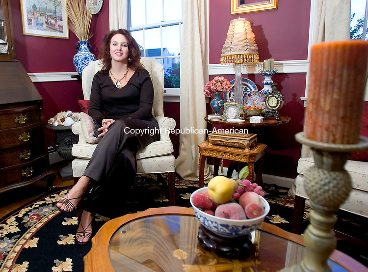 WATERTOWN, CT- 16 OCT 06- 101606JT20- <br /> Peggy Palomba, wearing a necklace, silk pants and a sequin top from Talbots with shoes from Ann Taylor, in her sitting room at her Watertown home.<br /> Josalee Thrift Republican-American