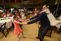 NWA Democrat-Gazette/BEN GOFF @NWABENGOFF<br /> TIm Law of Bentonville dances with his daughters Addyson Law (left), 7, and Reagan Law, 5, Saturday, Feb. 11, 2017, during the Father Daughter Valentines Dance at the Bentonville Community Center.