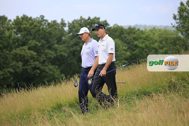 Ernie Els (RSA) and Jim Furyk (USA) walk off the 4th tee during Friday's Round 1 of the 2016 U.S. Open Championship held at Oakmont Country Club, Oakmont, Pittsburgh, Pennsylvania, United States of America. 17th June 2016.<br /> Picture: Eoin Clarke | Golffile<br /> <br /> <br /> All photos usage must carry mandatory copyright credit (&copy; Golffile | Eoin Clarke)