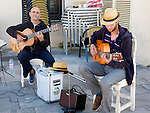 Two guitarist buskers performing in the street Ronda, Spain
