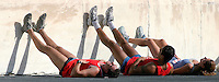 02 NOV 2003 - ATHENS, GREECE - Competitors recover after finishing the 21st Athens Classic Marathon in the Kallimarmaro Stadium. (PHOTO (C) NIGEL FARROW)