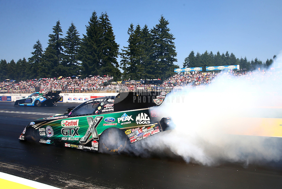 Aug. 3, 2014; Kent, WA, USA; NHRA funny car driver John Force during the Northwest Nationals at Pacific Raceways. Mandatory Credit: Mark J. Rebilas-USA TODAY Sports