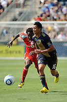 Michael Orozco Fiscal (16) of the Philadelphia Union is chased by Fuad Ibrahim (7) of Toronto FC. The Philadelphia Union defeated Toronto FC 2-1 on a second half stoppage time goal during a Major League Soccer (MLS) match at PPL Park in Chester, PA, on July 17, 2010.