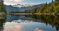 Sunrise at Lake Matheson with Mt. Cook (right) 3724m and Mt. Tasman (left) 3497m, two highest New Zealand mountains, Westland Tai Poutini National Park, West Coast, South Westland, UNESCO World Heritage Area, New Zealand, NZ