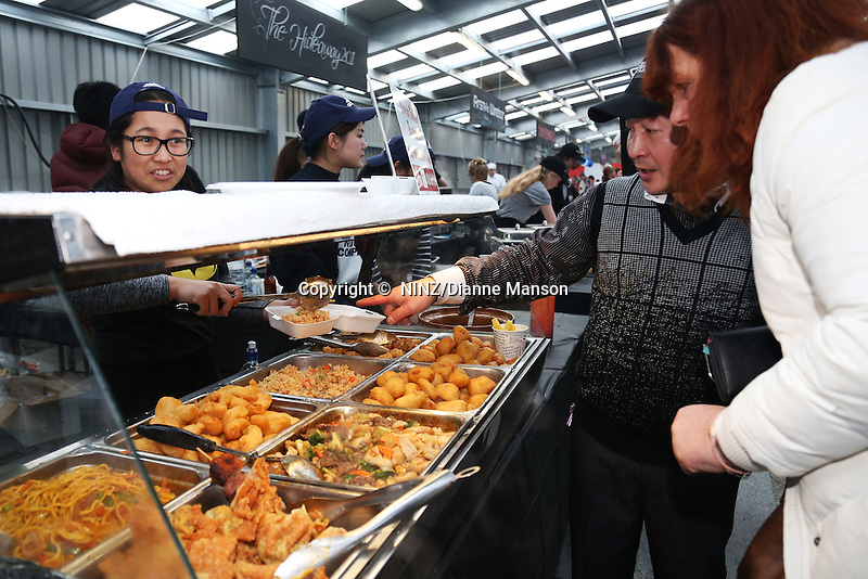Ocean Seafood restaurant food stall with their crispy skin pork, oysters, fish, won tons, combination chow suey and   rice & noodle meals during the Bluff Oyster and Food Festival, Bluff, New Zealand, Saturday, May 21, 2016. Credit:  Dianne Manson