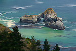 Offshore rock sea stacks in green ocean water along the Big Sur Coast, Monterey County, California