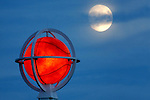 The moon rises behind the giant basketball atop the spire at the Naismith Memorial Basketball Hall of Fame in Springfield......