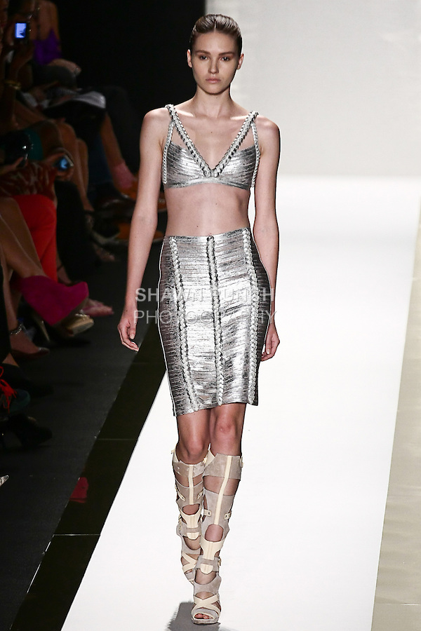 Amanda walks the runway in a silver foil bandage bra top, silver foil bandage skirt, and vapor gladiator boot, by Max Azria for the Herve Leger by Max Azria Spring 2012 fashion show, during Mercedes-Benz Fashion Week Spring 2012.