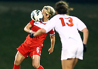 BOYDS, MARYLAND - April 06, 2013:  Lori Lindsey (6) of The Washington Spirit stops the ball against the University of Virginia women's soccer team in a NWSL (National Women's Soccer League) pre season exhibition game at Maryland Soccerplex in Boyds, Maryland on April 06. Virginia won 6-3.