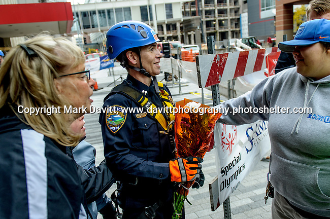 "There were hugs and congratulations for Captain Amy Kramer from the Pleasant Hill Police Department after she went ""Over the Edge"" of the 345-ft. Financial Center in Des Moines in support of Special Olympics Iowa Oct. 26."