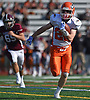 Patrick McGrath #22 of Carey rushes for a touchdown during a Nassau County Conference II varsity football game against host Garden City High School on Saturday, Sept. 29, 2018. Garden City won by a score of 38-14.