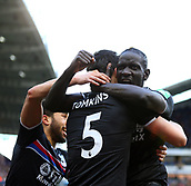 17th March 2018, The John Smiths Stadium, Huddersfield, England; EPL Premier League football, Huddersfield Town versus Crystal Palace; James Tomkins of Crystal Palace is hugged by Mamadou Sakho and Andros Townsend after he scored in the 26th minute to make it 0-1