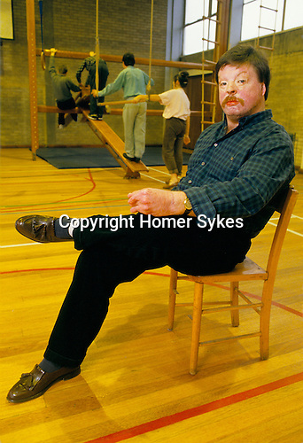 Welsh veteran Simon Weston sitting in a gymnasium, founder of charity Weston Spirit helping disadvantage young people..