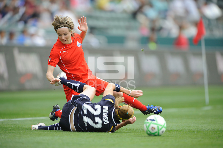 Los Angeles Sol Manya Makoski (22) and Washington Freedom Sonia Bompastor (8) battle for the ball at the Home Depot Center in Carson, CA on Sunday, March 29, 2009.
