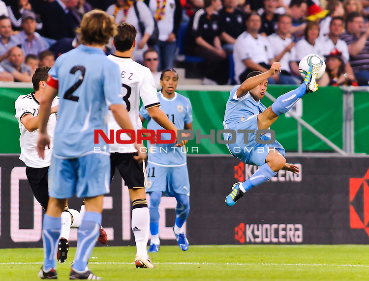 29.05.2011, Rhein-Neckar-Arena, Sinsheim, GER, LS FSP, Deutschland (GER) vs Uruguay (UY), im Bild Walter Gargano (R) of Uruguay jumps for the ball during the Football Friendly Ship betweem Germany and Uruguay  for the Rhein-Neckar-Arena in Sinsheim, Germany, 2011/05/29, Foto © nph / Roth