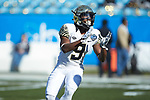Chuck Wade Jr. (9) of the Wake Forest Demon Deacons warms up prior to the game against the Texas A&M Aggies at Bank of America Stadium on December 29, 2017 in Charlotte, North Carolina.  The Demon Deacons defeated the Aggies 55-52.  (Brian Westerholt/Sports On Film)